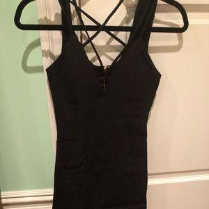 Strappy tight black knee length dress